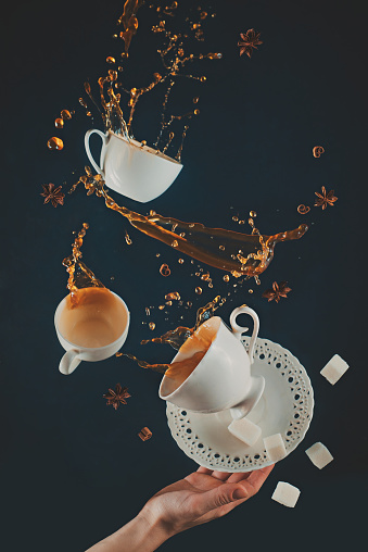 Flying coffee cups with saucer, dynamic splashes and falling sug - gettyimageskorea