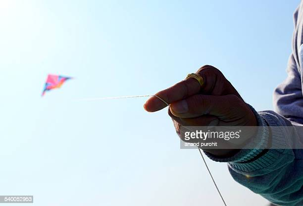 flying colourful kite in clear blue sky, india - makar sankranti stock pictures, royalty-free photos & images