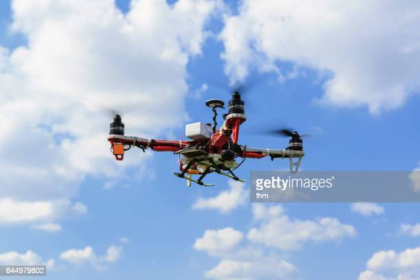 flying drone - uav unmanned aerial vehicle - remote controlled stock photos and pictures