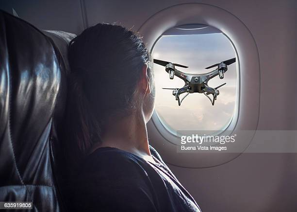 Flying drone viewed from airplane window