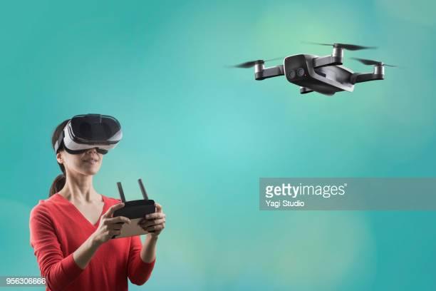 flying drone with a pilot - 仮想空間の視点 ストックフォトと画像