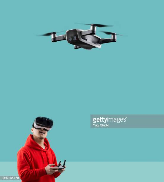 flying drone with a pilot - drone stock pictures, royalty-free photos & images