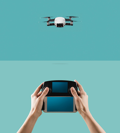 A flying drone with Control Device. - gettyimageskorea
