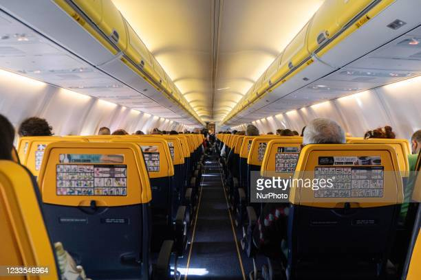 Flying during the Covid-19 Coronavirus pandemic inside a Boeing 737-800 aircraft of Ryanair low cost carrier with destination Chania in Crete Island,...