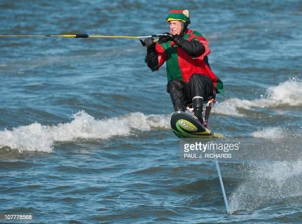 A Flying Elf water skis down the Potomac River on Christmas Eve on a ski chair that pops out of the water several feet December 24 at Maryland's...
