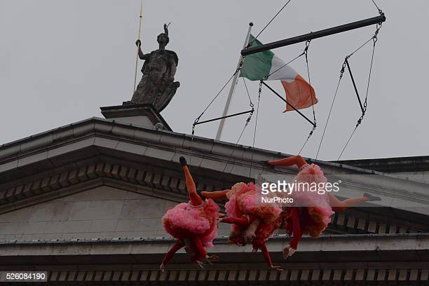 Flying Elves in Dublin's city center over the GPO building as Dublin City Council surprise Christmas shoppers with Flying Elves on O'Connell Street a...