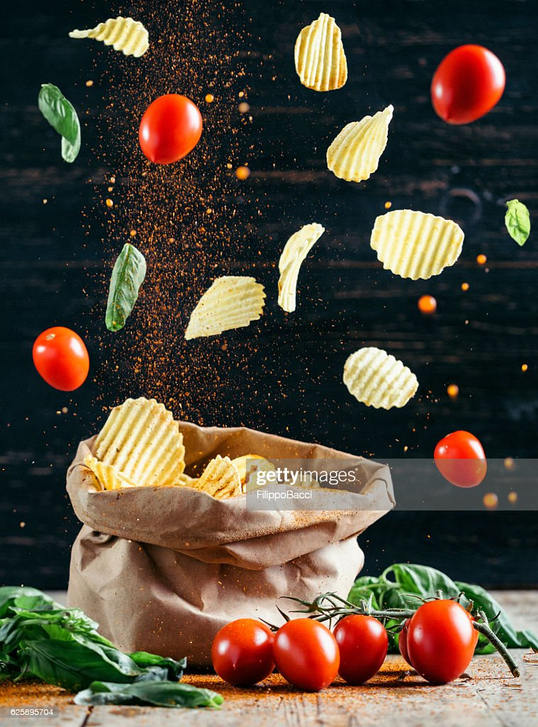 Flying Food Chips And Tomatoes Stock Photo Getty Images