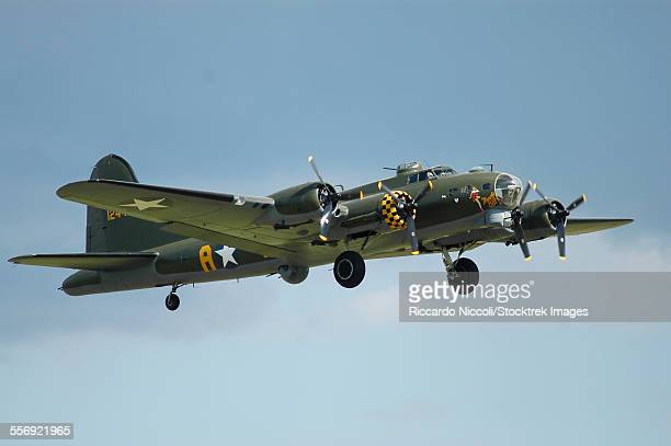 B-17 Flying Fortress in World War II United States Army Air Corps colors taking off from Duxford airport, England.