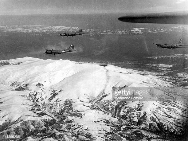 Flying Fortresses of the Allied 15th Air Force flying over a mountain range Bulgaria March 1944