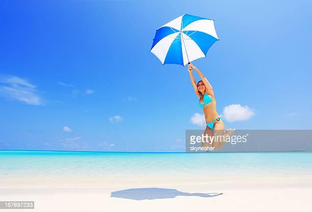 Flying girl with umbrella.