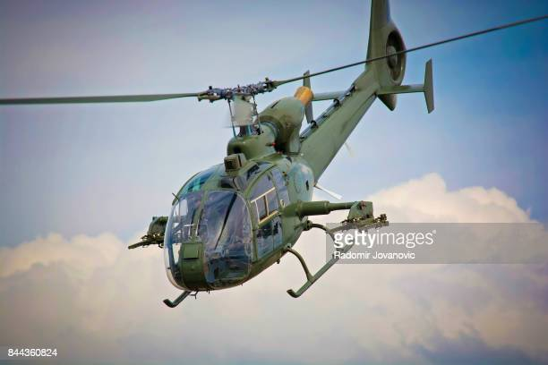 flying helicopter - military helicopter stock photos and pictures