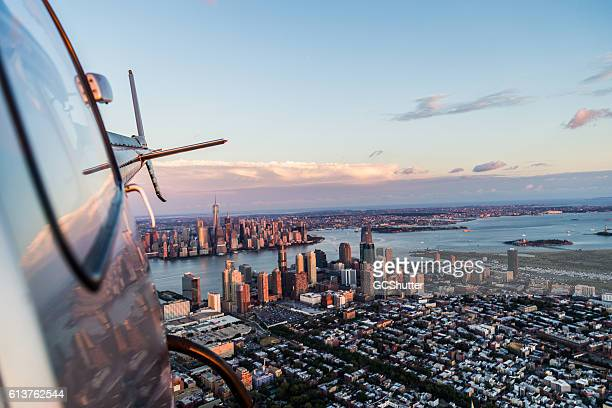 flying high and looking back! - helicopter stock pictures, royalty-free photos & images