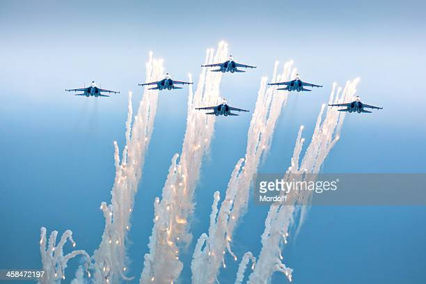 Flying in formation Russian Knights aerobatic team releasing fireworks
