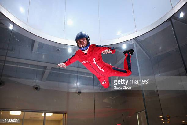 Flying instructor David Schnaible demonstrates wind tunnel flying at the iFly indoor skydiving facility on May 29 2014 in Rosemont Illinois Guests at...