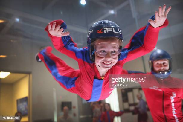 Flying instructor David Schnaible teaches wind tunnel flying to nineyearold Liam Harrison at the iFly indoor skydiving facility on May 29 2014 in...