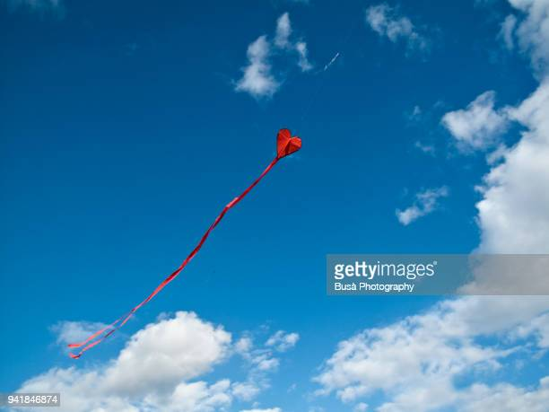 Flying kite in the shape of a heart in Berlin, Germany
