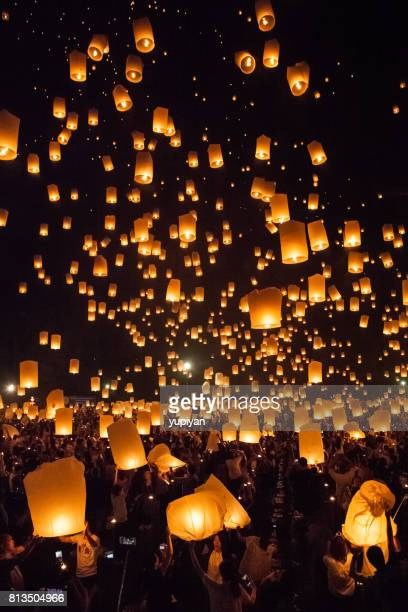 flying lantern at loy krathong in thailand - lantern stock photos and pictures