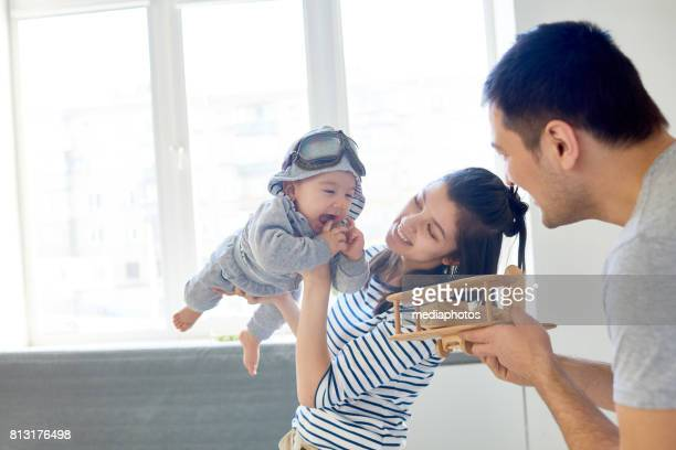flying like plane - asian baby stock photos and pictures