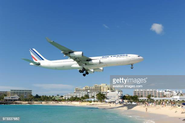 flying low on finalapproach landing over Maho Beach with hotels behind