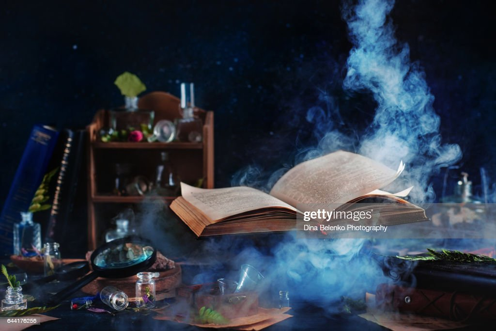 Flying magical book with smoke : Stock Photo