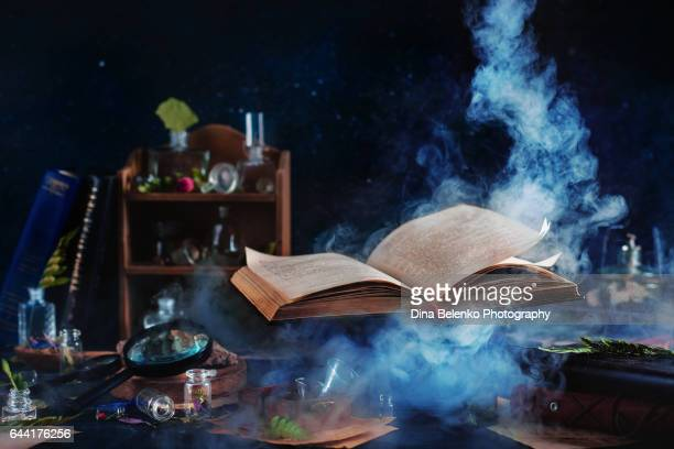 flying magical book with smoke - literature stock pictures, royalty-free photos & images