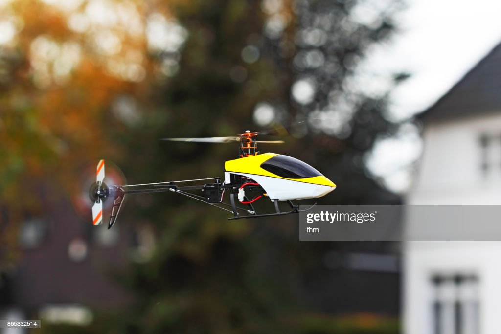 Flying model helicopter : Stock Photo