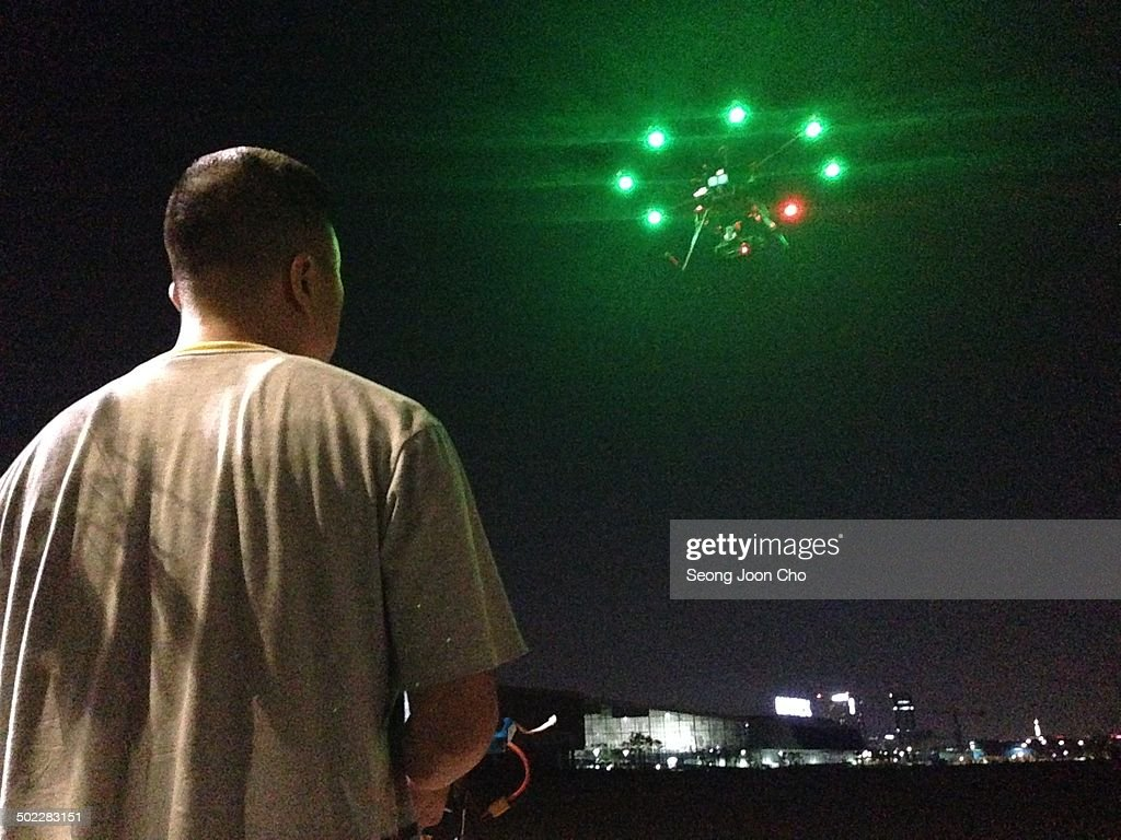 Flying Octocopter Drone At The Background Of Kintex Night In Goyang South Korea