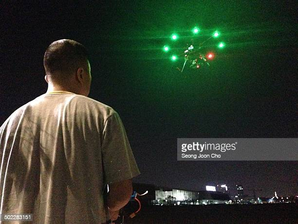 Flying octocopter drone at the background of Kintex at night in Goyang, South Korea.