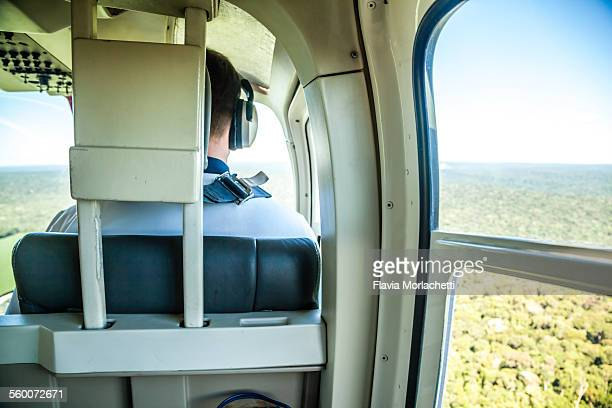 flying on a helicoper - inside helicopter stock pictures, royalty-free photos & images