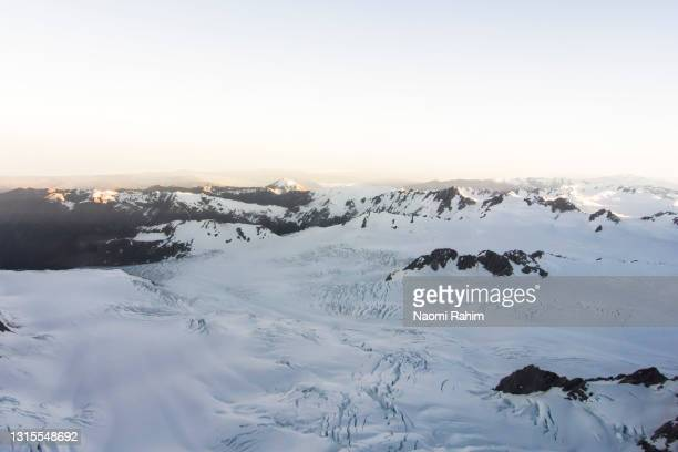 flying over beautiful snowcapped mountain range and glaciers in new zealand - 2017 stock pictures, royalty-free photos & images