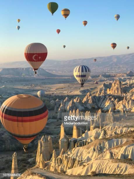 flying over cappadocia in a hot air balloon - cappadocia stock pictures, royalty-free photos & images