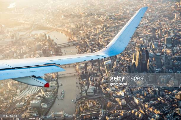 flying over london's city centre - aeroplane stock pictures, royalty-free photos & images