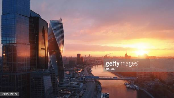 flying over moscow international city business center at sunrise - moscow international business center stock photos and pictures