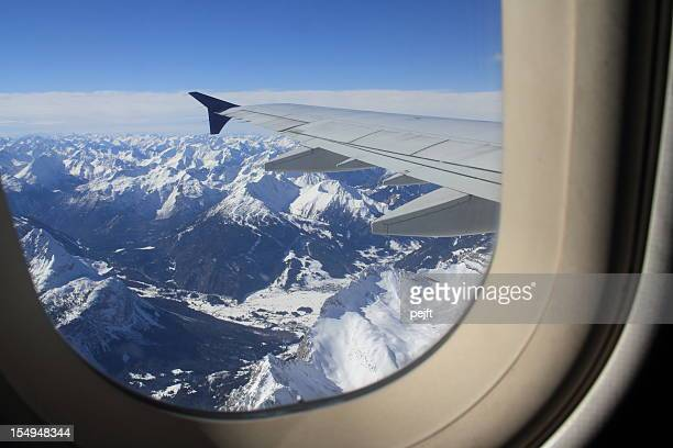 flying over snow covered austrian alps mountain peaks - pejft stock pictures, royalty-free photos & images