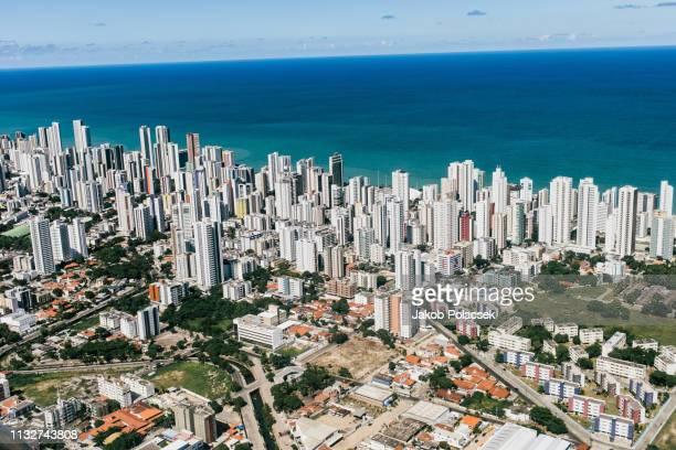 flying over the city of recife - recife stock-fotos und bilder