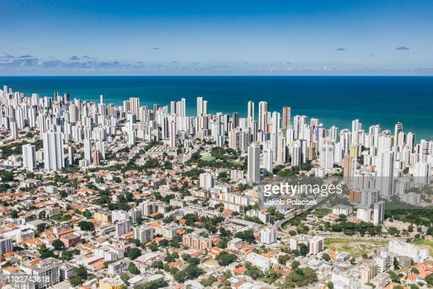 flying over the city of recife - recife stock pictures, royalty-free photos & images