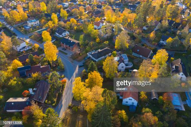 flying over villa and tree area just at sunset - residential district stock pictures, royalty-free photos & images