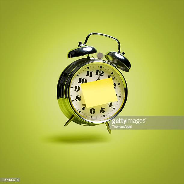 flying retro alarm clock with sticky note - hovering stock pictures, royalty-free photos & images
