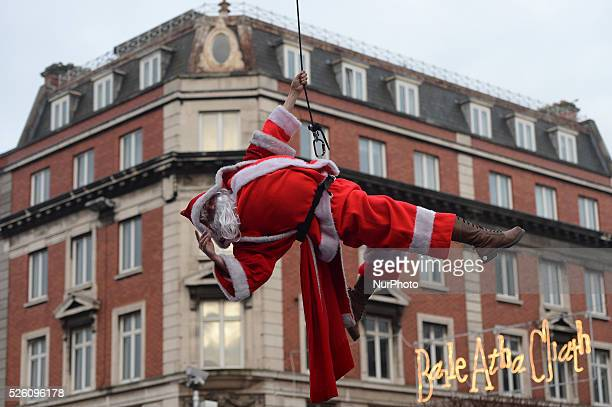 Flying Santa Claus in Dublin's city center as Dublin City Council surprise Christmas shoppers with Flying Elves on O'Connell Street a show run by...