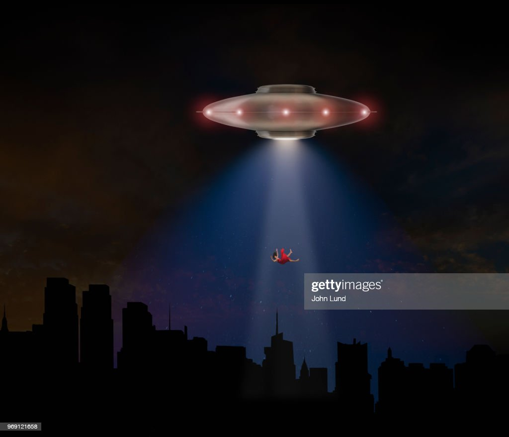 UFO Flying Saucer Abduction A Woman : Stock Photo
