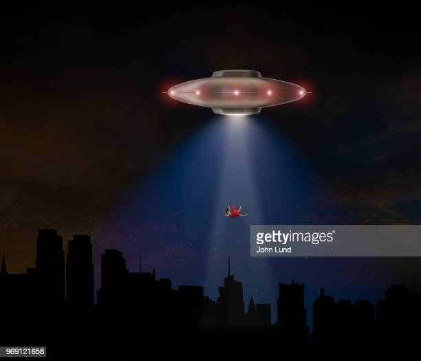 ufo flying saucer abduction a woman - john lund stock pictures, royalty-free photos & images
