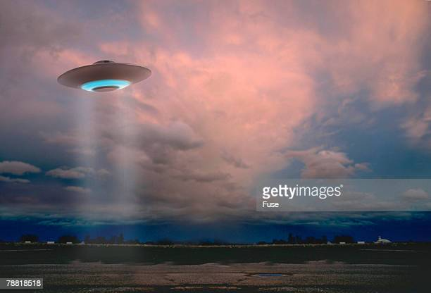 Flying Saucer over an Open Field at Dusk