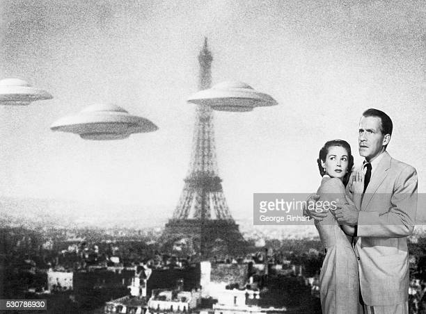Flying saucers are sighted over Paris in this movie scene from Earth vs the Flying Saucers The frightened couple at right are portrayed by stars Hugh...