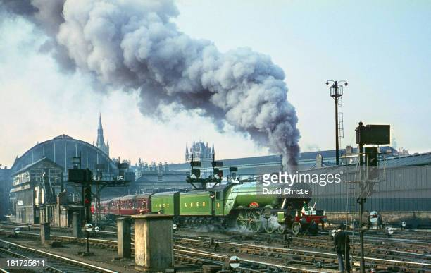 Flying Scotsman departs Kings Cross on her special on 30/4/67. Note the railwayman taking what looks like a box brownie type photograph! 4472 ran...