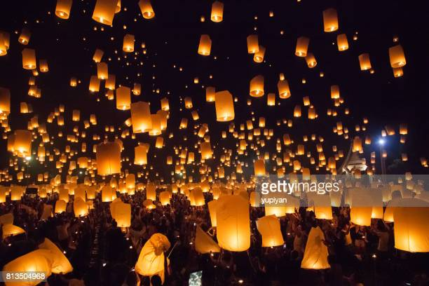 flying sky lantern at loy krathong in thailand - lantern stock photos and pictures