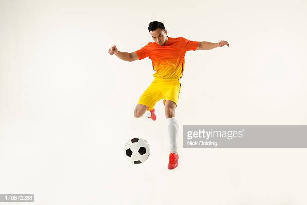 flying sports, football 03 - kicking stock pictures, royalty-free photos & images