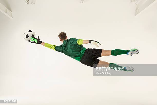 flying sports, football 18 - football player stock pictures, royalty-free photos & images