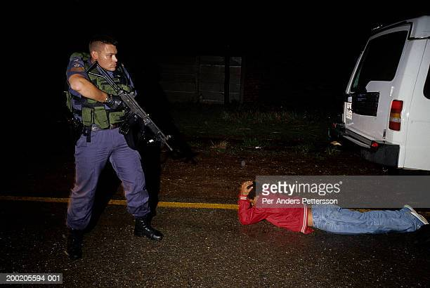 flying squad police officer arrests suspected car thief - 1999 stock pictures, royalty-free photos & images