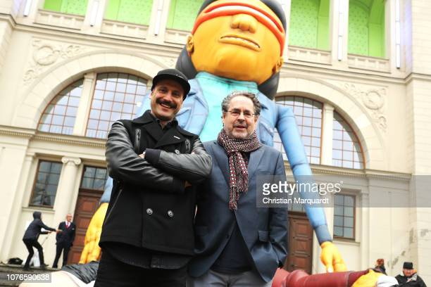 Flying Steps' artistic director Vartan Bassi and Director of the National Gallery Berlin Udo Kittelmann pose in front of a 18m high giant figure,...