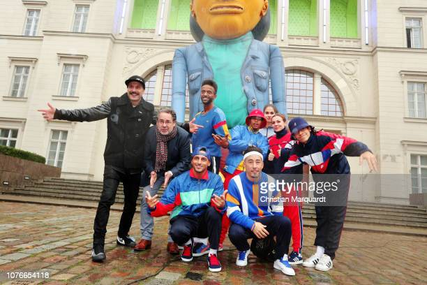 Flying Steps' artistic director Vartan Bassi, Director of the National Gallery Berlin Udo Kittelmann and members of the ensemble pose in front of a...